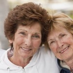 Portrait of two senior female friends smiling