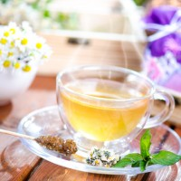 Cup of tea on a natural background consist of flowers