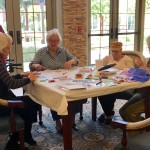 Here is the whole group working hard making cards.