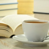 Books cup of coffee on the table