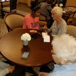 Residents getting help with their iPhones.