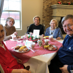 Juanita, Glenda, Neeley and her daughter, along with Ron enjoy brunch together.