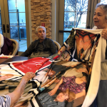 Mary shares about her family displayed on a blanket that was given to her as a gift.