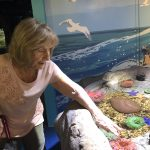 Donna gets up close and personal with the sea anemones.