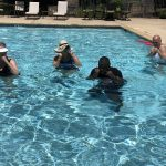 Residents participate in aqua boxing class